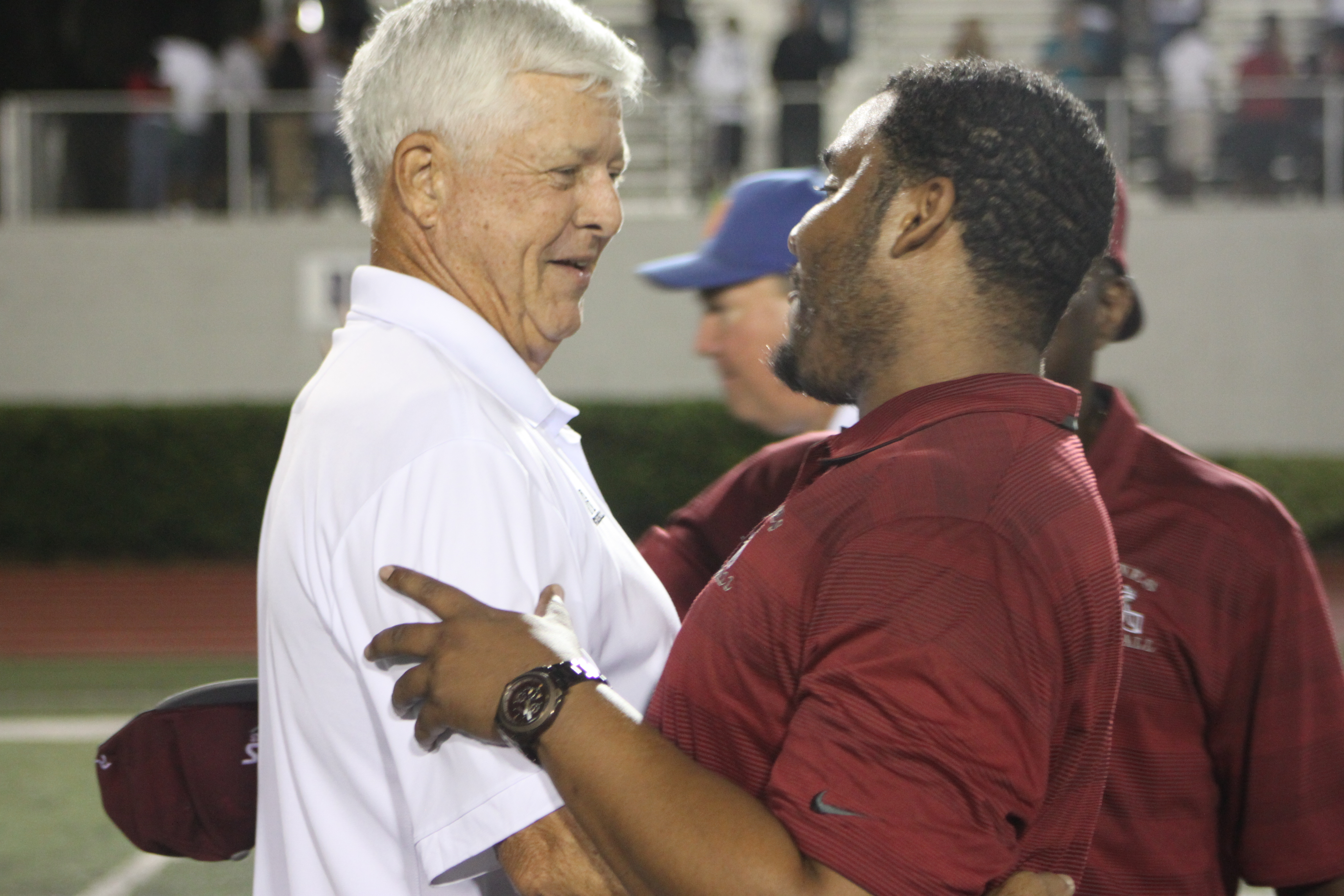 Head Coaches Corky Rogers (Bolles) and Deran Wiley (Raines) embrace after their hard faught game last week
