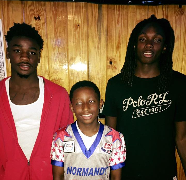 Ed White's Xavion Allen, Normandy's Javon Nobles, and Dupont's Jacobi Myers pose together as Duval Sports Players of the Week